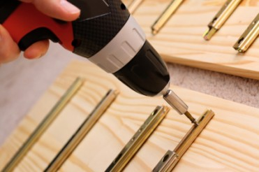 Mounting wooden furniture with cordless screwdriver
